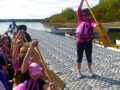 Joanie shows our guests how to hold a paddle