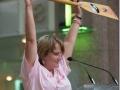 Joanie raises our paddle